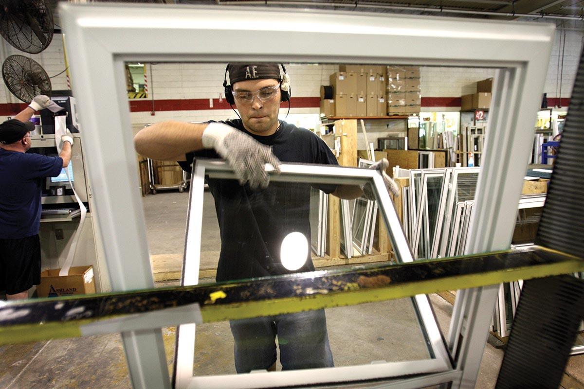 Man assembling window