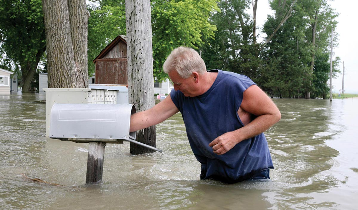 Man and mailbox in flood